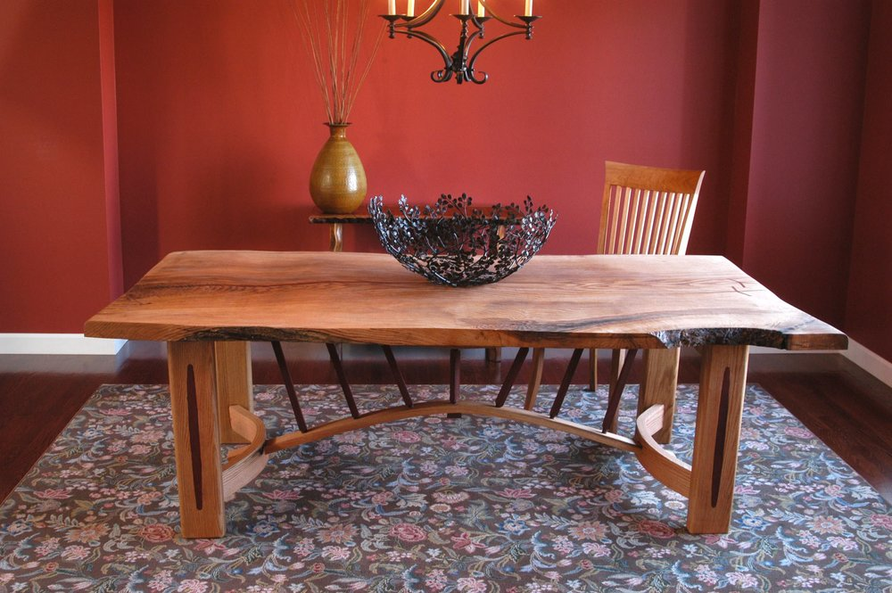 This custom made live edge wood dining table was made from a slab of walnut.