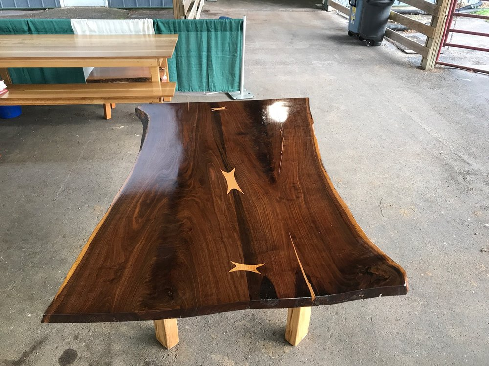Check out this coffee table made with a beautiful walnut slab and it's knots are filled in with oak