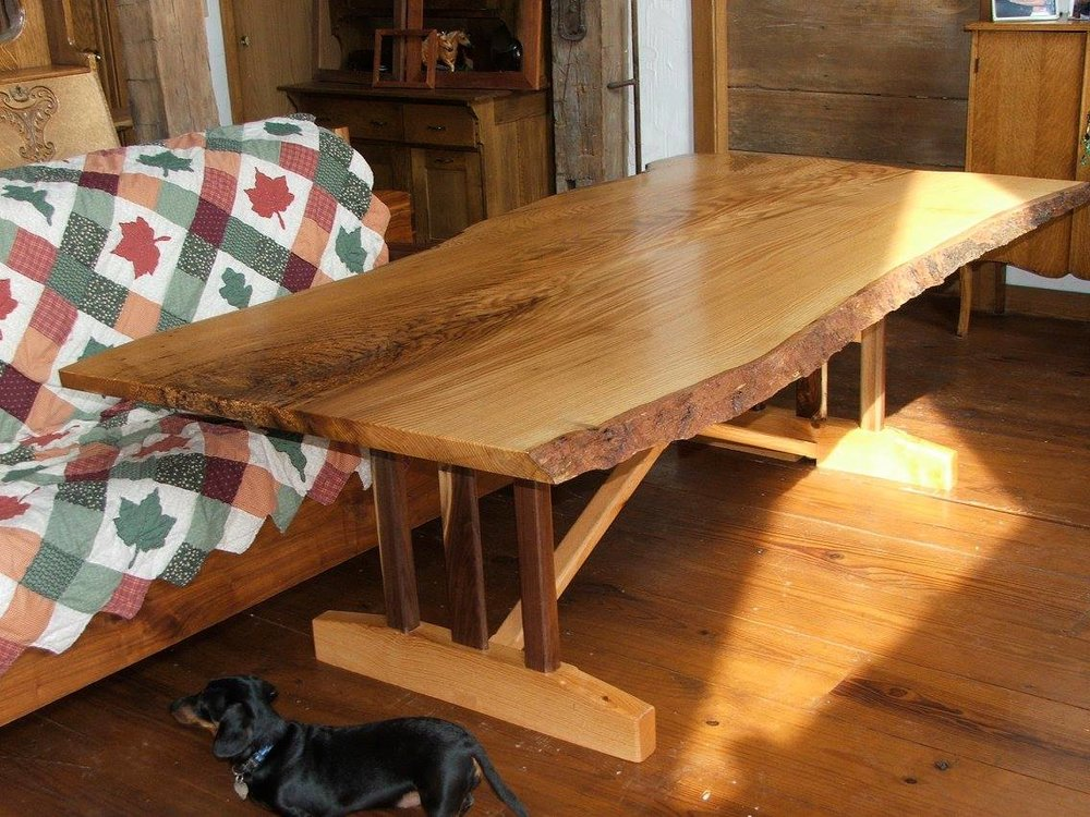This is a custom piece of live edge wood furniture. This beautiful tabletop was made by Woods of Wisdom