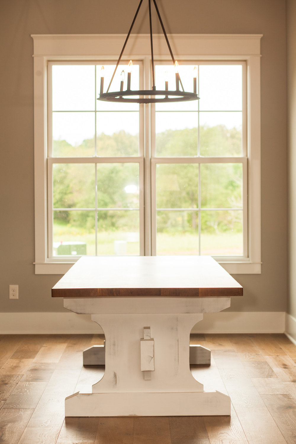 Quarter sawn white oak table with a white painted base custom made by Woods Of Wisdom side view