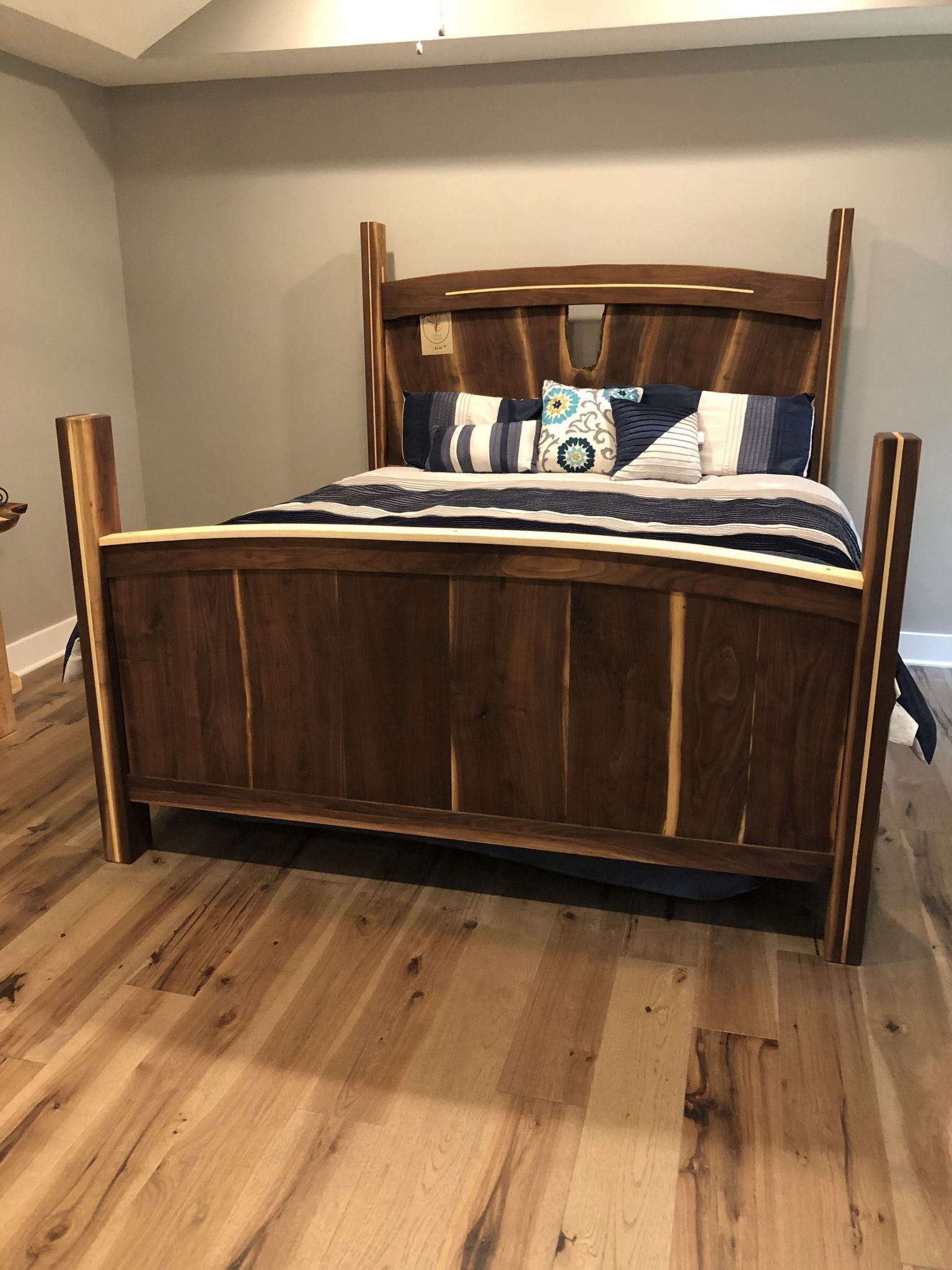 Handcrafted king size walnut bed with maple accents.