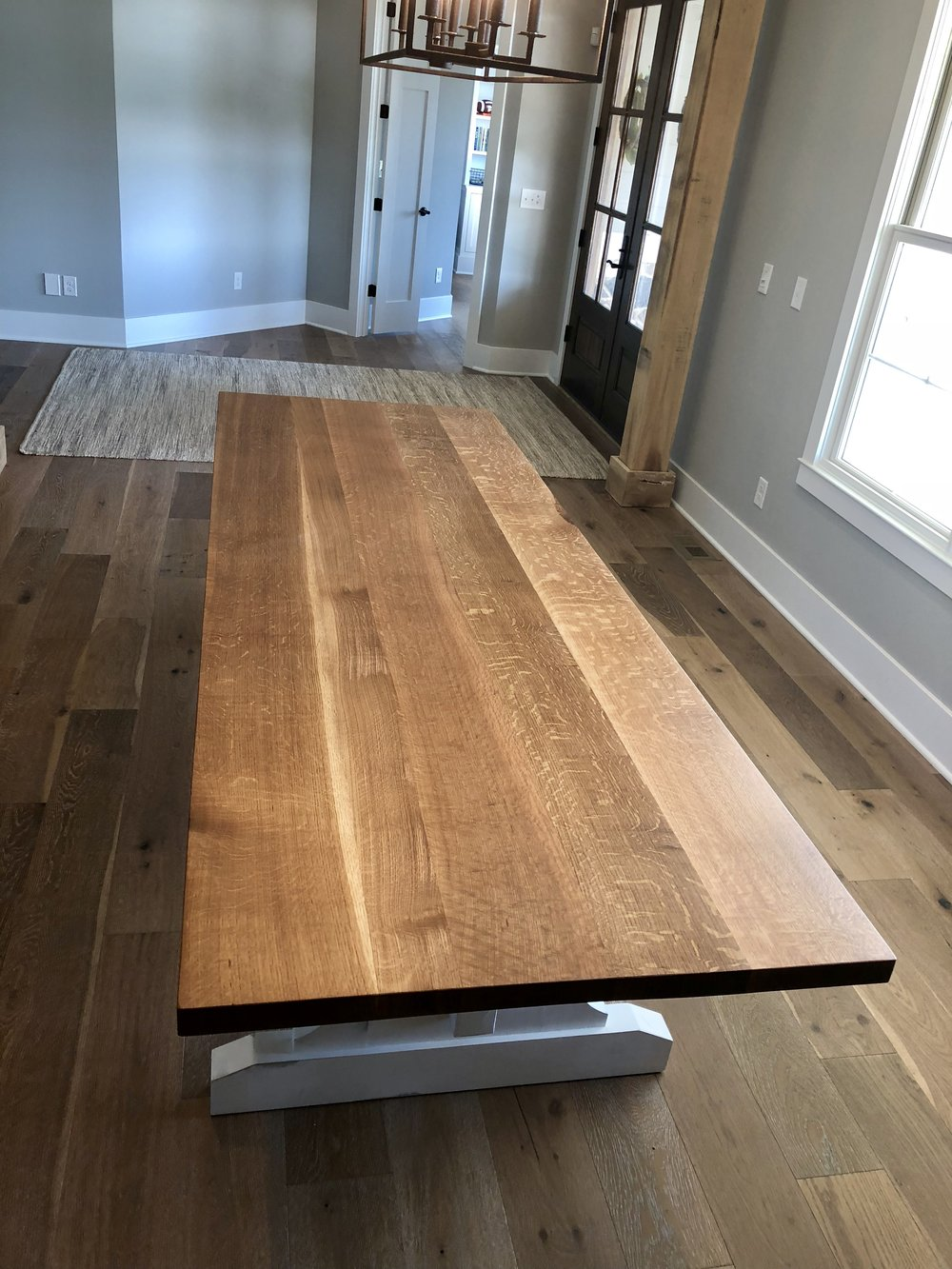 Quarter sawn white oak table with a white painted base custom made by Woods Of Wisdom