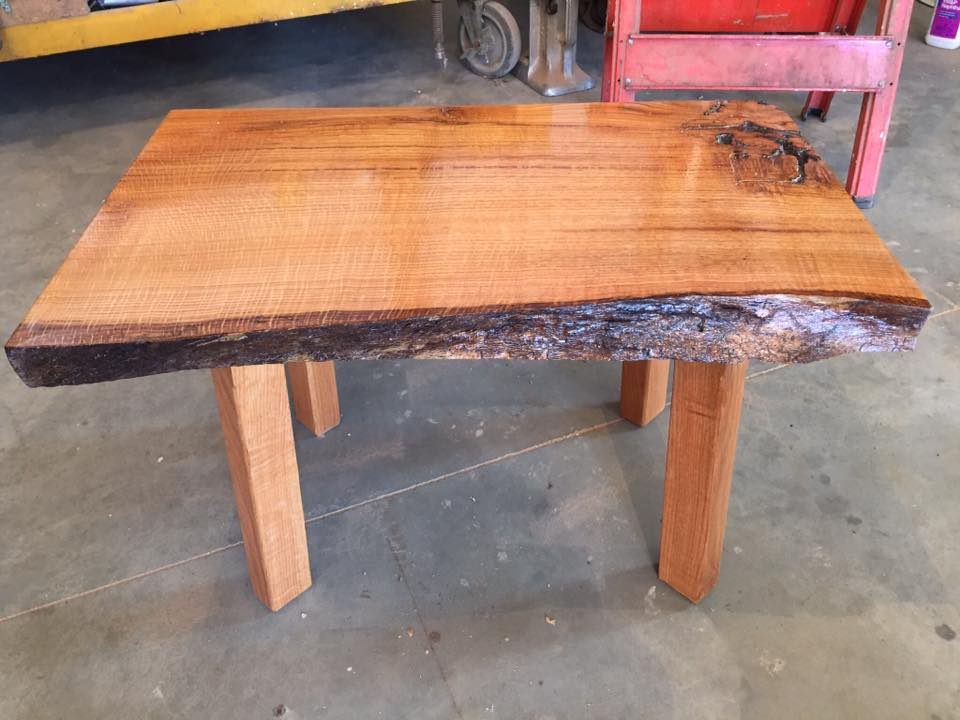 Live edge wood coffee table customly made by the father and son duo at Woods of Wisdom