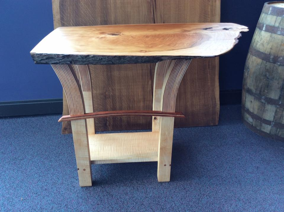 This custom live edge end table is perfect for a living room or bedroom.
