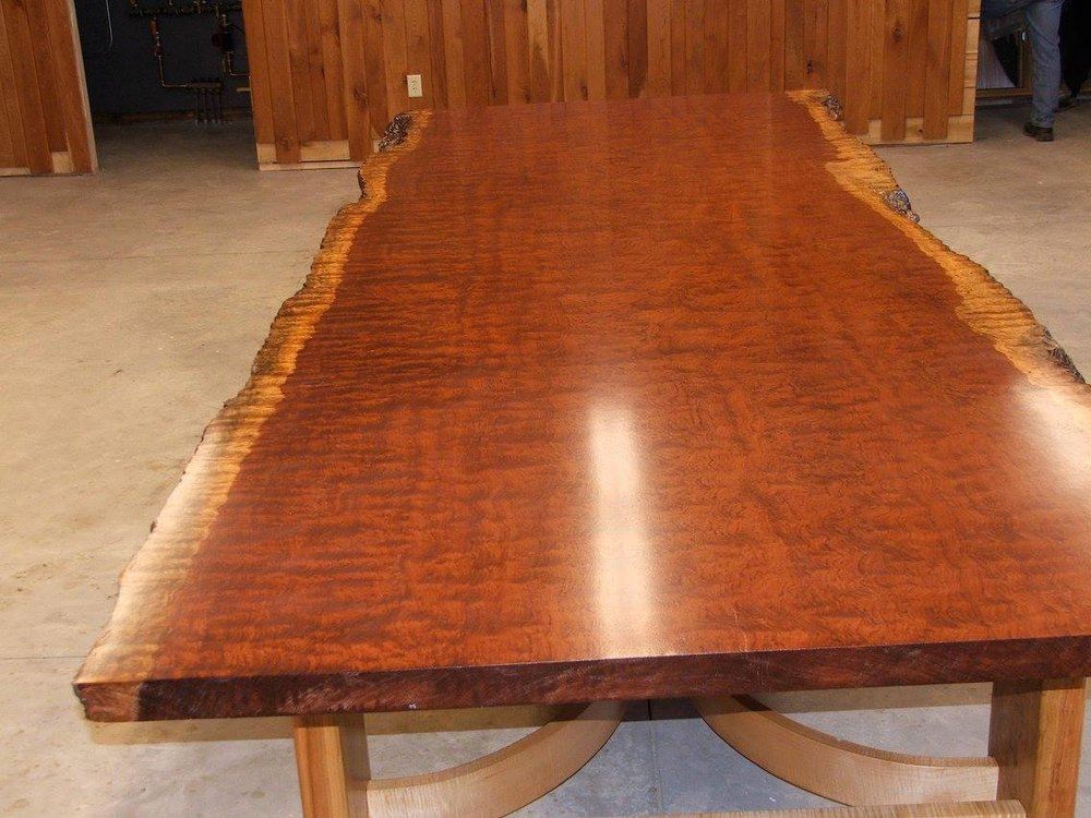A one of a kind handcrafted live edge table made by Woods of Wisdom