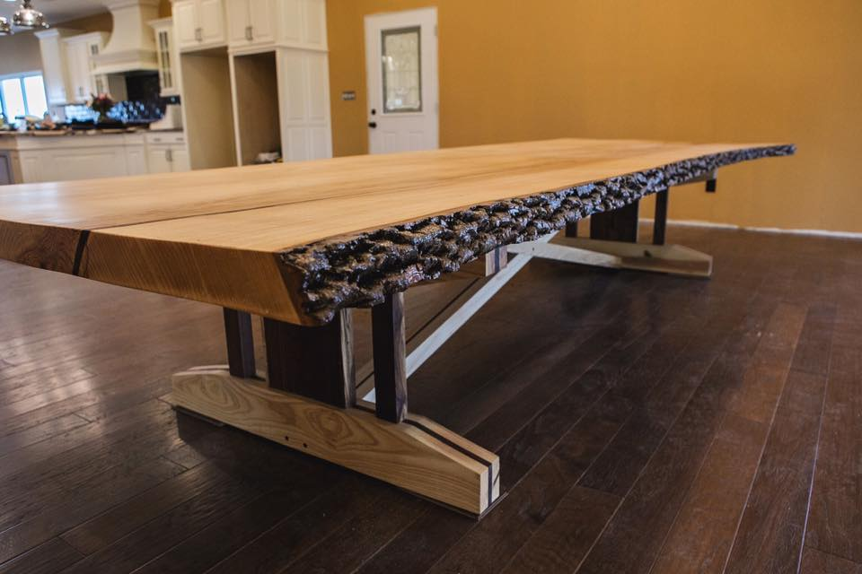Live edge wood slab dining room table that looks perfect in any home.